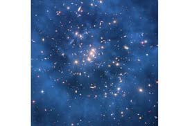 """""""This image captured by the Hubble Space Telescope shows a 'ring' thought to be caused by dark matter, in the galaxy cluster ZwCl0024+1652. Scientists at Vanderbilt University have developed a relatively straightforward explanation for this mysterious substance."""" PHOTO: NASA/ESA"""